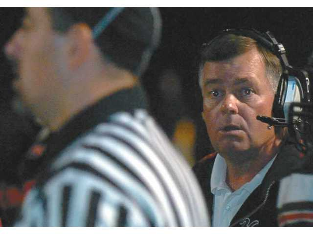 Former Hart High defensive coordinator Rick Herrington looks toward a referee during a game Nov. 16. After 30 years coaching at Hart High, Herrington has accepted the defensive coordinator position at Alemany High in Mission Hills.
