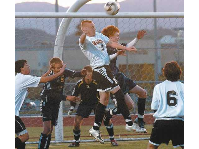 Valencia High's Dan Palmer (10) and West Ranch High's Matt Barraso, right, jump for a header in the first half of the Vikings' 1-0 victory over the Wildcats.03