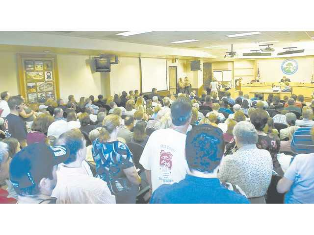 Residents of Saugus filled two rooms at City Hall as the City Council held a forum Tuesday to discuss removing barricades on Benz Road.