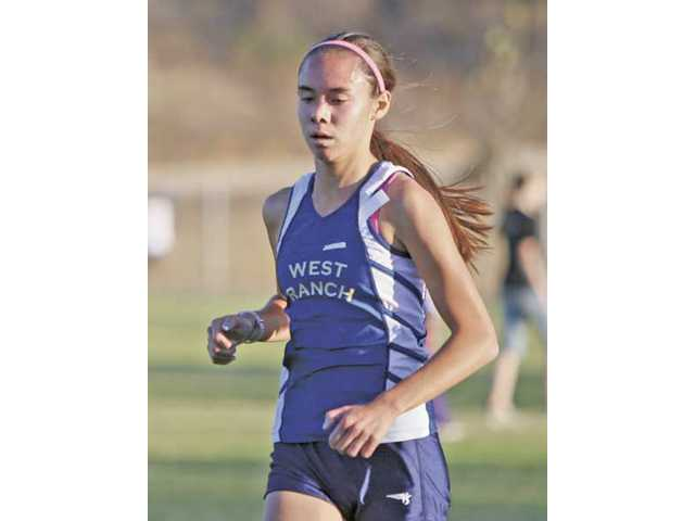 West Ranch's Jennifer Owen runs during the girls race. Owen finished in first place with a time of 17 minutes, 59 seconds, five seconds in front of the next closest competitor.