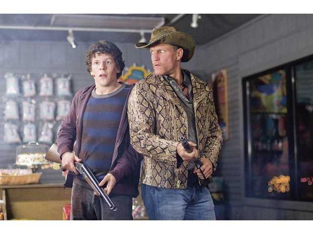 "Jesse Eisenberg, left, and Woody Harrelson are shown in a scene from Columbia Pictures' ""Zombieland."""