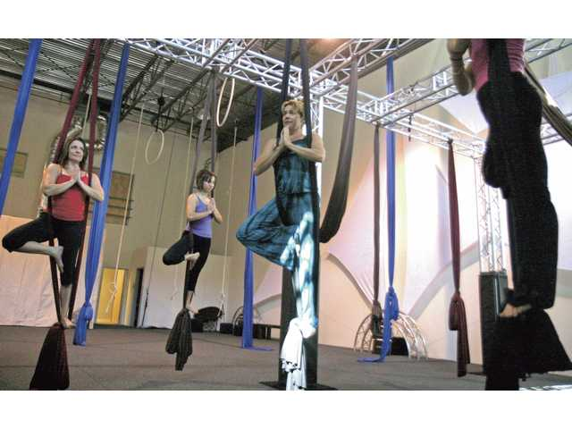 Debbie Park, center, leads (left to right) Wendy Hassenpflug, Laura Grenot, and Kinsley Johnson in a Vozdu class at Aerial Experience Productions in Valencia.