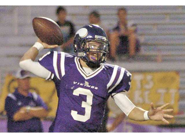 Valencia quarterback Alex Bishop tosses a pass Sept. 18 at Valencia High. Bishop has thrown for 792 yards and 10 touchdowns this season.