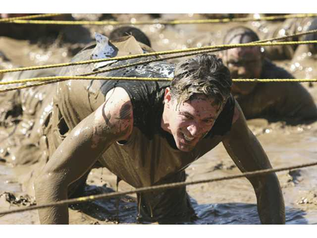 Fitness Edge Boot Camp instructor Steven Tako participates in the annual Mud Run.
