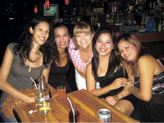 Santa Clarita resident Kay Thatcher, middle, poses with a group of sex workers in Chiang Mai, Thailand over the summer. Thatcher was one in a team of 11 women and two men that traveled to Thailand this summer with a Grace Baptist Church missions trip. The team reached out to women who are victims of human trafficking.