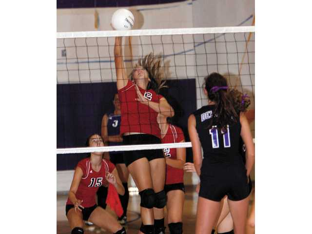 Hart girls volleyball player Rachel Richan makes a successful kill on Thursday in a match at Valencia High School.