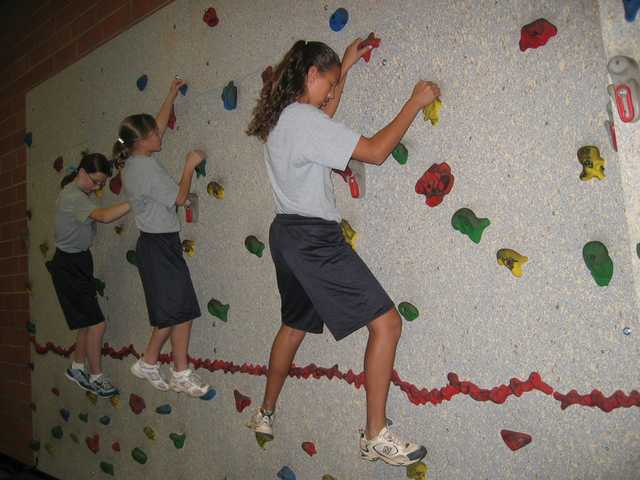 Sierra Vista students climb the rock wall in the school's fitness center.