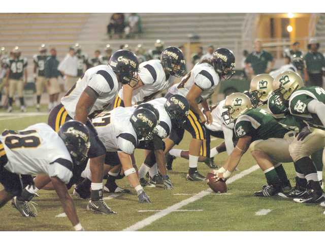 College of the Canyons' defense lines up against Los Angeles Valley College on Sept. 19. COC's defense will need another strong performance tonight as it matches up with undefeated Allan Hancock.