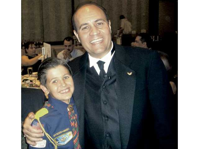 Peyton Halaby, 9, a Cub Scout for three years and father Arif Haliby of Total Financial Solutions, title sponsor of the Leaders of Character dinner for the past four years.