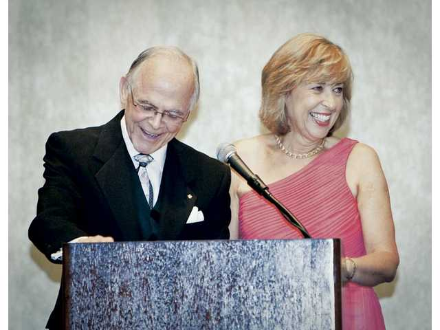 Bill Kennedy addresses the crowd at the Hyatt Regency Valenica with wife Cathy.