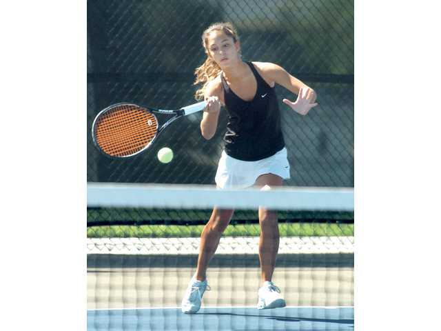 Valencia's Clarice Fraczek returns a volley at the Fall Brawl at Valencia High on Saturday.