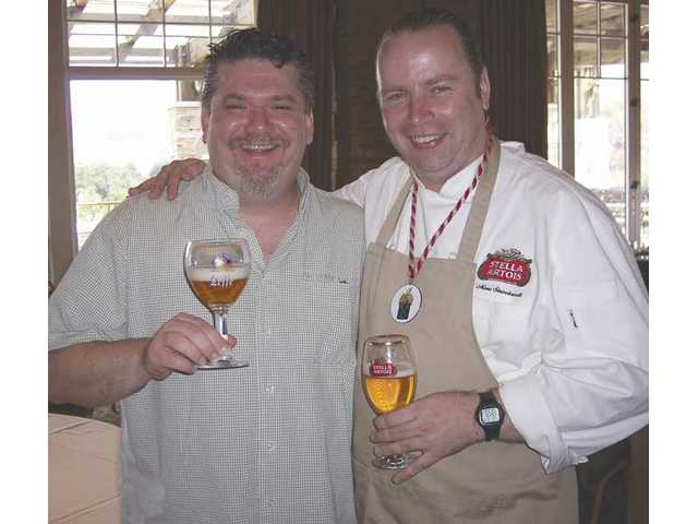 Peter Goossens, left, founder of the Loose Goose Wine Festival has a beer with Marc Stroobandt, master beer sommelier, at the beer and food pairing luncheon held to kick off the 2008 Loose Goose Wine Festival. The Belgian Beer Cafe is a new addition to the festival, which will run from 1 to 5 p.m. today in Bridgeport Park.