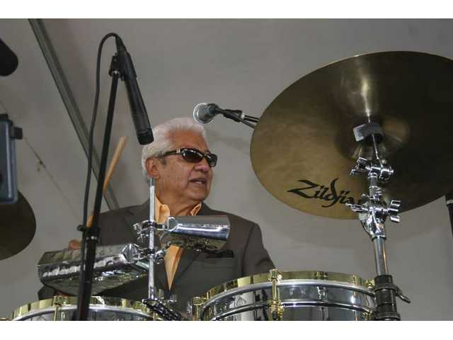 Latin jazz legend Pete Escovedo and sons Juan and Peter Michael fronted the Escovedo family orchestra Sunday afternoon to close the fourth annual Loose Goose wine festival. The group has headlined the festival the past three years.