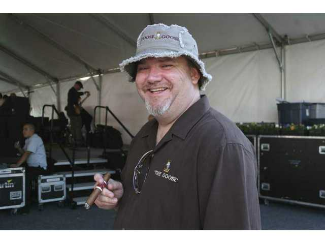 Peter Goosens waits to introduce the Pete Escovedo Orchestra, headliners at the 2008 Loose Goose Wine Festival in Valencia.