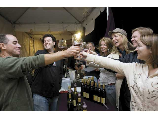 Victor Abascal, far left, and participants of the Loose Goose Wine Festival share a toast Saturday night. About 10,000 people attended the four-day event.