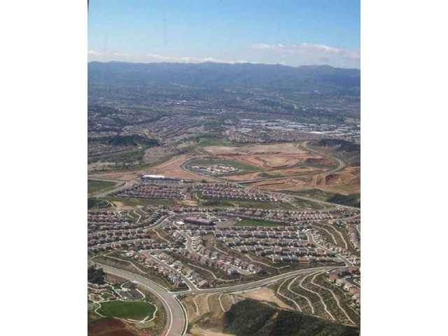 A view to the west, with Rio Norte Junior High in the center, shows the scope of housing development in the surrounding areas of the Santa Clarita Valley.