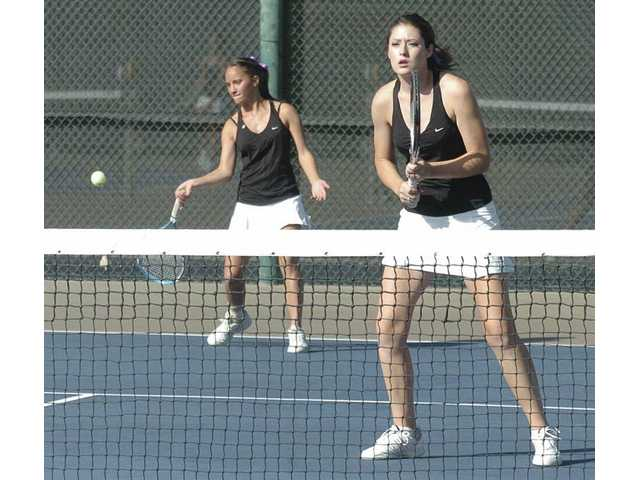 Valencia's Andrea Zammit, left, returns a shot as teammate Chelsie Dietz looks on Tuesday at Valencia High. The Vikings won 12-6.