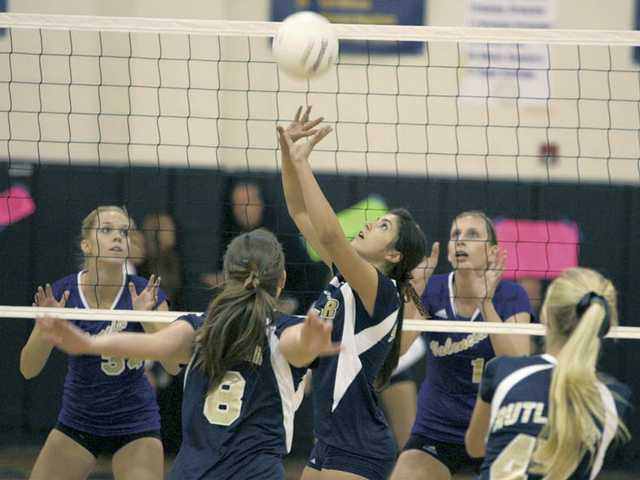 West Ranch setter Tani Slauson, center, sets for teammates Courtney Cessna (8) and Angelica Rutledge (47) as Valencia players Heidi Brown (34) and Katie Hank (18) look on Tuesday at West Ranch High School.