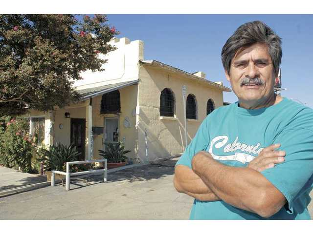 Manny Santana stands by the century old Newhall jail Friday in Newhall.