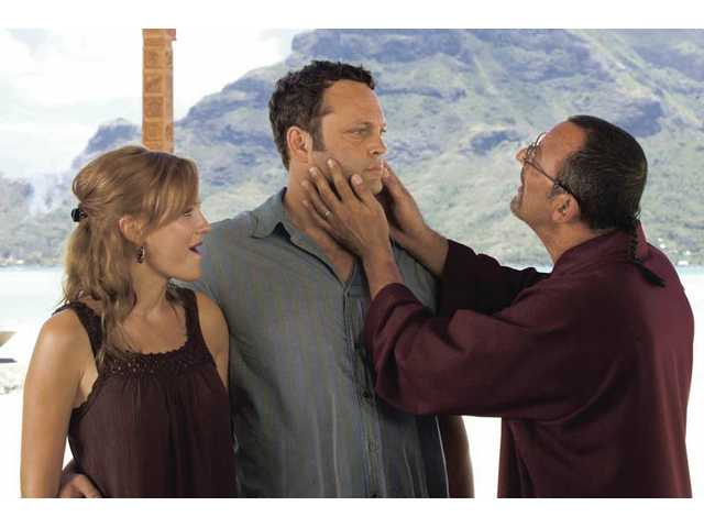 "Malin Akerman, left, Vince Vaughn, center, and Jean Reno are shown in a scene from ""Couples Retreat."""