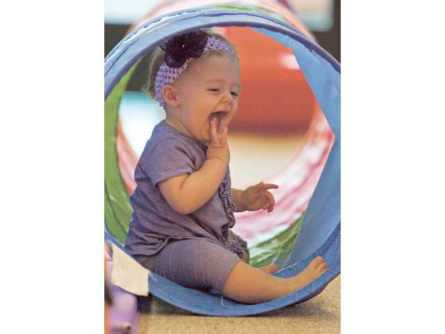Eight-month-old Miranda Rust of Canyon Country enjoys a little playtime at Gymboree while her mother attended the SCV Baby Network's first seminar at Valencia's Gymboree on Sept. 24.