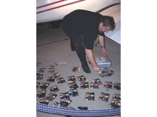 Yoti Telio scatters laminated photos for guests to claim at the end of the gala.