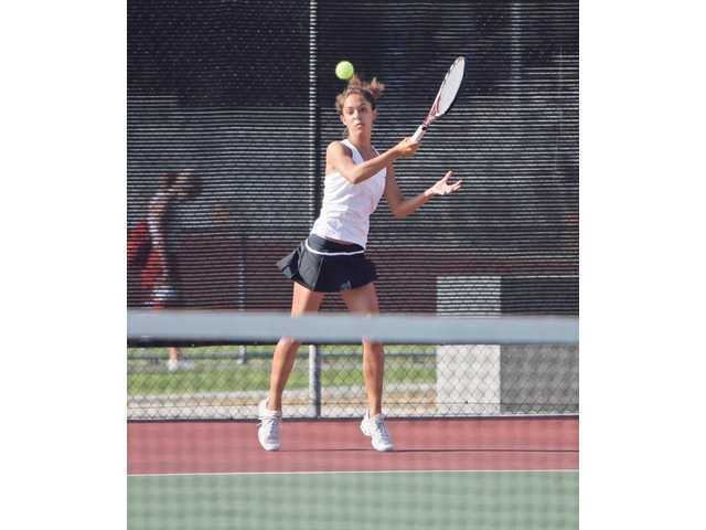 Valencia No. 1 singles player Emily Fraczek returns a shot Thursday against Hart at Hart High School.