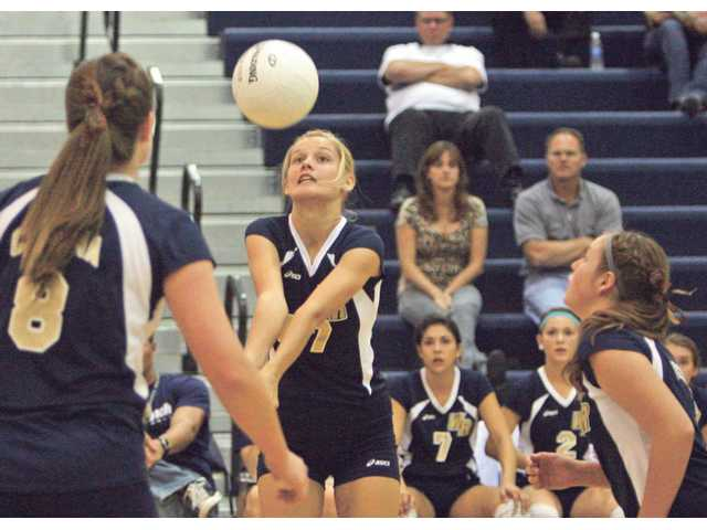 West Ranch sophomore Angelica Rutledge, middle, hits the ball Thursday against Saugus at West Ranch. The Wildcats won 2-1.