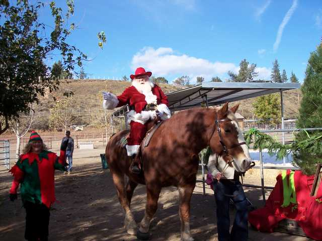 Santa arrives by horseback for the first time at Santa Day at Carousel Therapeutic Riding Ranch in Agua Dulce.