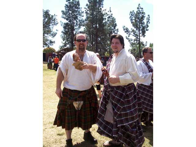 Manly men abound at the Renaissance Pleasure Faire. This duo enjoys a pair of turkey legs for a lunch repast.