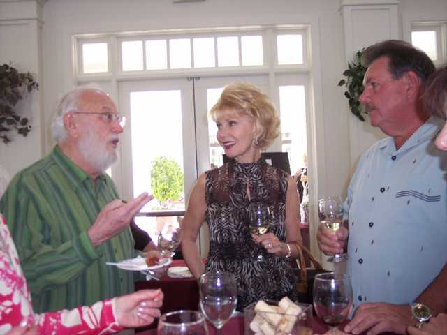 Guests, left to right, Frank Kleeman, Debbie and John Heys, at the eighth annual Vine 2 Wine fundraiser to benefit the Betty Ferguson Foundation.