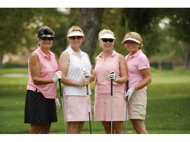 Judy Davis, Diane Ayres, Virginia Cina and Bonnie Gowing take a break on the course during the Rally for the Cure tournament at Valencia Country Club. The effort raised money for Breast Cancer awareness.