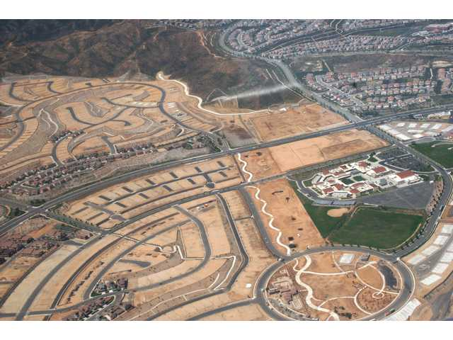 Part 3: An aerial view shows thehousing and small business development around Rio Norte Junior High in April.