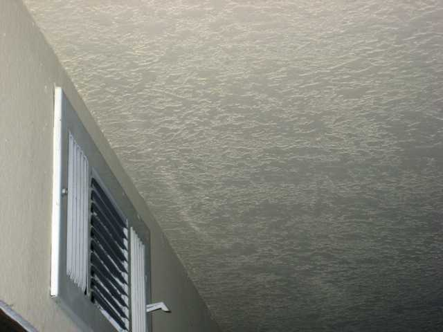 "A popcorn ceiling can be replaced with various textures. ""Knock-down,"" show here, is popular."