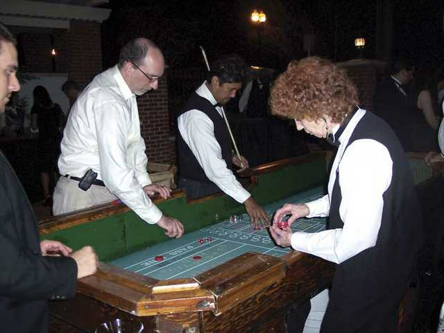 Guests enjoy casino games at the annual Canyon Theatre Guild fundraiser held at the community theater in Newhall.