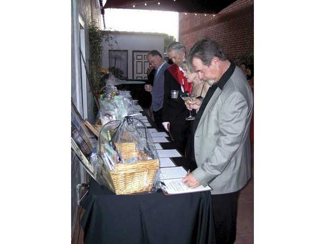 Guests at 'Casino Royale 008' peruse auction items. The live auction raised more than $12,000 for the Canyon Theatre Guild.