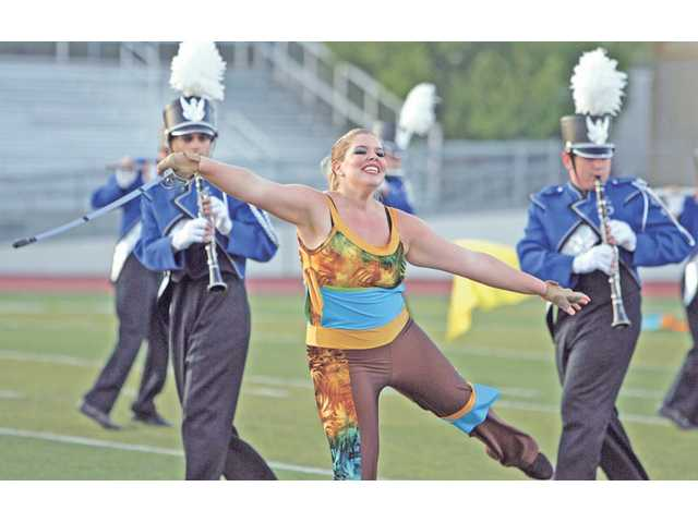 "Saugus High School marching band and color guard perform ""Journey of Delight: The Music of Cirque du Soleil"" on Oct. 10 at Valencia High School, during the Wildcat Classic Marching Band Competition hosted by West Ranch High School."