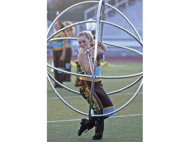 A member of the Saugus High marching band and color guard performs Saturday at the Wildcat Classic at Valencia High School.