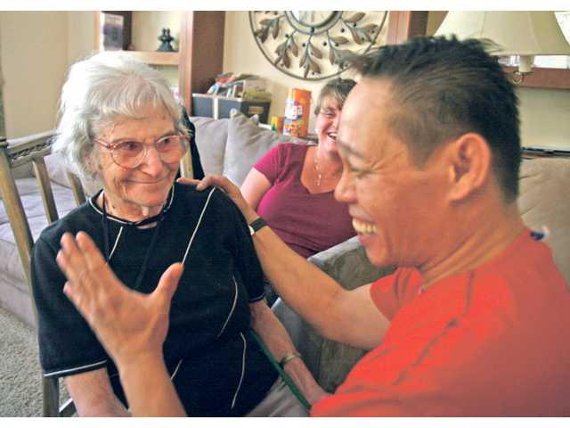 Resident Esther Bobrow, left, makes caregivers Rachel Chavira and Jay Valenzuela laugh at Mameleh and Tatleh's Upscale Senior Living in Canyon Country.
