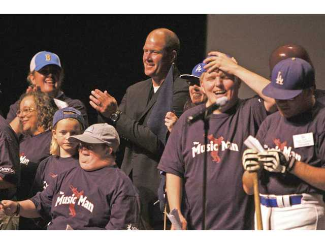 "Former Angels pitcher Jim Abbott, center, who was born without a right hand, was on stage Thursday with the LETMESAIL drama group for ""An Evening of inspiration"" at the Santa Clarita Performing Arts Center on the campus of College of the Canyons."