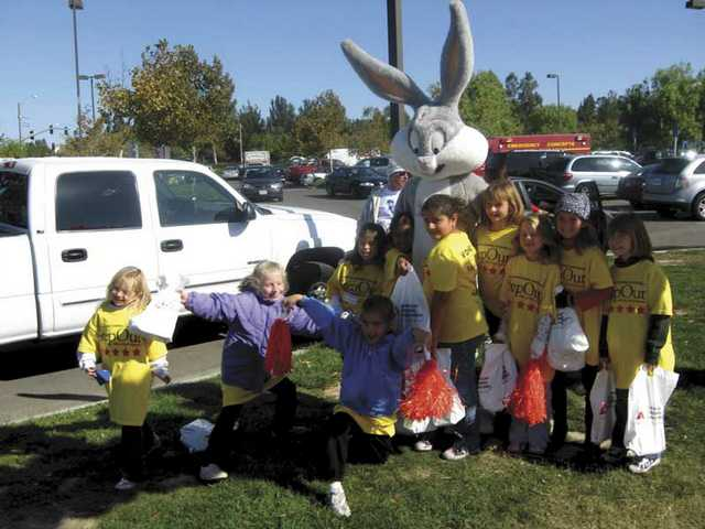 Kids pause to pose with Bugs Bunny at the Walk to Fight Diabetes Sunday. The fund raiser drew more than 1,000 people to Bridgeport Elementary School. The kid volunteers handed out gift bags to walkers.