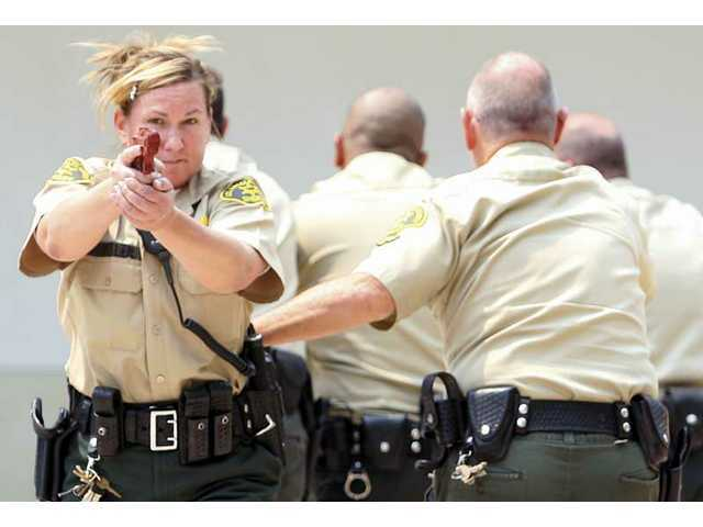 Part 7: Santa Clarita Valley Sheriff's Department deputies train. As the valley's population grows, so does the need for a larger sheriff's force.