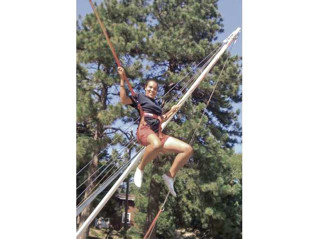 Rancho Pico student Alexis Clewis enjoys the feeling of weightlessness on the zero gravity device at Pali Mountain.