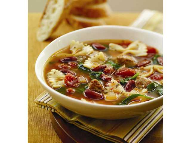Italian-Style Soup With Turkey SausageMakes 8 (1-cup) servingsPrep Time: 10 minutes Cook Time: 30 minutes    1     tablespoon olive oil     8     ounces sweet or hot         Italian-style turkey         sausage, cut into         1/2-inch thick slices     1/2     cup chopped onion     1     can (32 ounces)         reduced sodium         chicken broth     1     can (15 1/2 ounces)         red kidney beans,         rinsed and drained     1     can (14 1/2 ounces)         no salt added diced         tomatoes, undrained     1     teaspoon         McCormick         Oregano Leaves     1     teaspoon         McCormick         Rosemary Leaves,         finely crushed     1     teaspoon         McCormick Thyme         Leaves     1     package (6 ounces)         baby spinach leaves     1/2     cup uncooked small             pasta, such as mini             bowties or elbows 1. Heat oil in large saucepan on medium heat. 2. Add sausage; cook and stir 3 minutes. 3. Add onion; cook and stir 3 min­utes longer or until onion is tender and sausage is browned. 4. Pour chicken broth, beans and tomatoes into sauce­pan. 5. Stir in oregano, rose­mary and thyme. 6. Bring to boil. Reduce heat to low; simmer 10 minutes. 7. Stir in spinach and pasta. Return to boil on medium-high heat. 8. Reduce heat to low; cover and simmer 10 minutes or until pasta is tender.