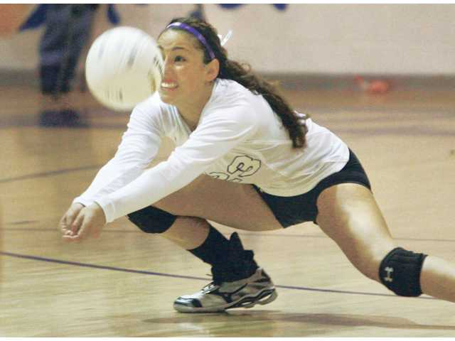 Valencia's Brooke Dawson digs out a ball against Saugus during their match Tuesday at Valencia High.