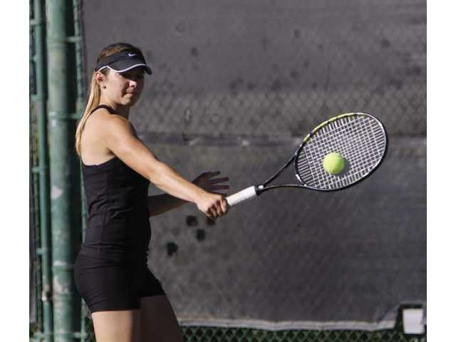 Valencia's Thalia Wilczinski returns a shot in her 6-0 win over Canyon's Julienne Carandang in a battle of the No. 2 singles tennis players for each school on Tuesday afternoon.