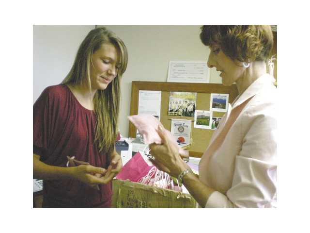 "Sara Strode, left, created ""Hugs in a Mug"" to bring hope and comfort to breast cancer patients. Colleen Shaffer, right, is the founder of Circle of Hope breast cancer support group which will distribute Strode's creation to cancer patients."