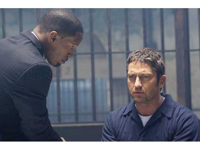 "Jamie Foxx, left, and Gerard Butler are shown in a scene from Overture Films' ""Law Abiding Citizen."""