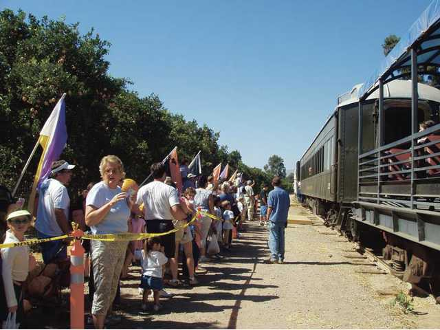 PumpkinLiner riders get ready to board the train, which takes them on a scenic ride to a private pumpkin patch.