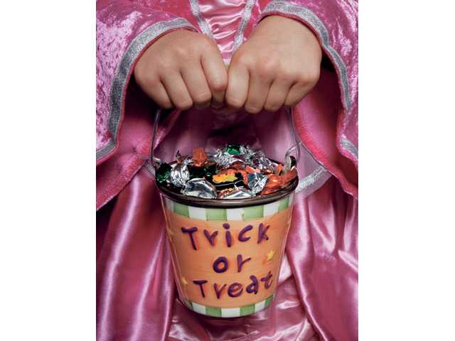Courtesy photo(Left) Children can turn their candy into cash on Nov. 2 at Drs. Allen & Kelly Smudde.